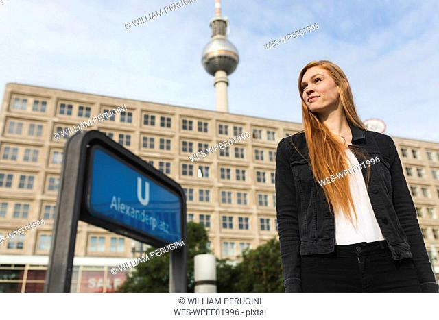 Portrait of redheaded young woman at Alexanderplatz, Berlin, Germany