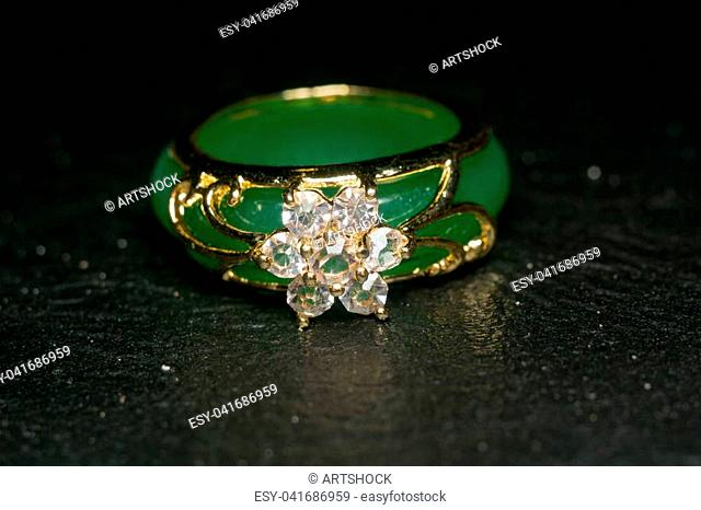 Green jade ring decorated with diamonds and gold setting
