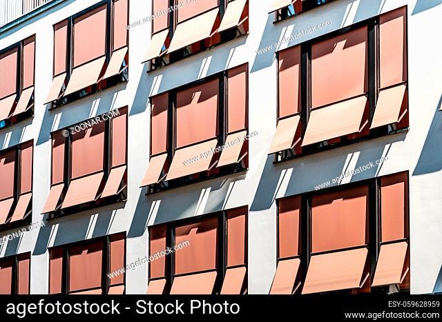 sun blinds on building facade , modern sunshades / awnings