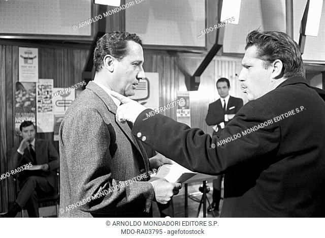 Italian actor Alberto Sordi directed by Italian director Luigi Filippo D'Amico on the set of the film Complexes, segment Guglielmo il dentone. 1965