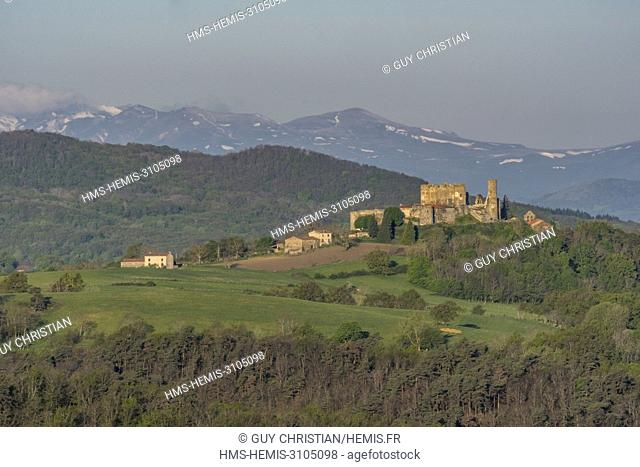 France, Puy de Dome, Montmorin castle in the Natural Regional Park of Livradois Forez and in the background the Regional Natural Park of the Volcanoes of...