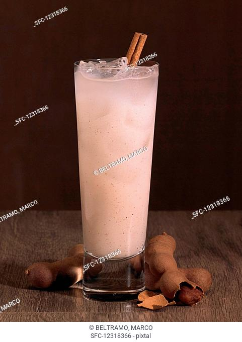 A drink with pink tamarind juice