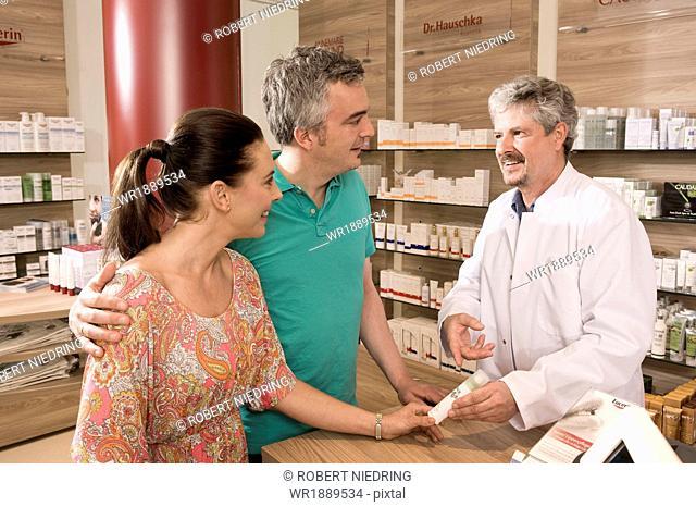Couple In Pharmacy, Munich, Bavaria, Germany