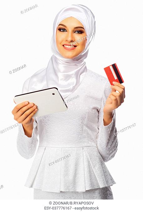 Muslim woman with tablet PC and card isolated