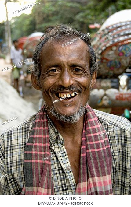 Rickshaw Puller Looking at Camera ; Dhaka ; Bangladesh