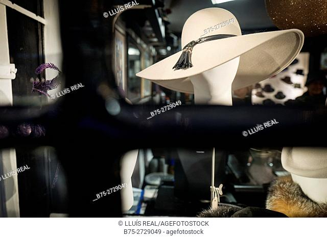Hat shop, display of elegant woman's hats in shop window. James Lock and Co., London, England