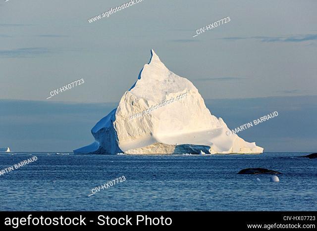 Majestic iceberg formation on sunny Atlantic Ocean Greenland