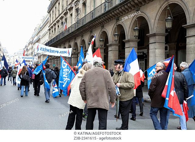 French National Front political party supporters march down Rue des Pyramides during the party's traditional May Day rally in Paris, France, 01 May 2013, Europe