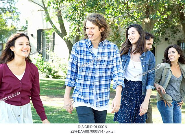 College friends walking together outdoors