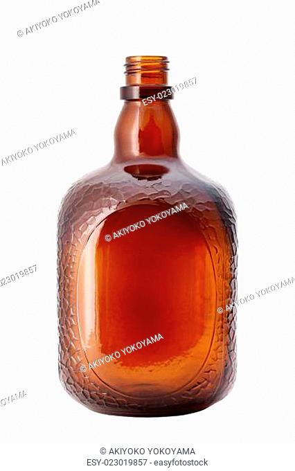 Brown glass bottle on white