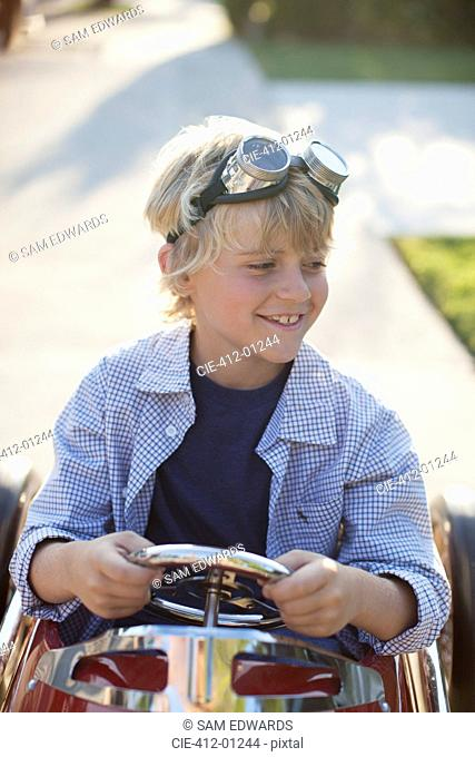 Smiling boy playing in go cart
