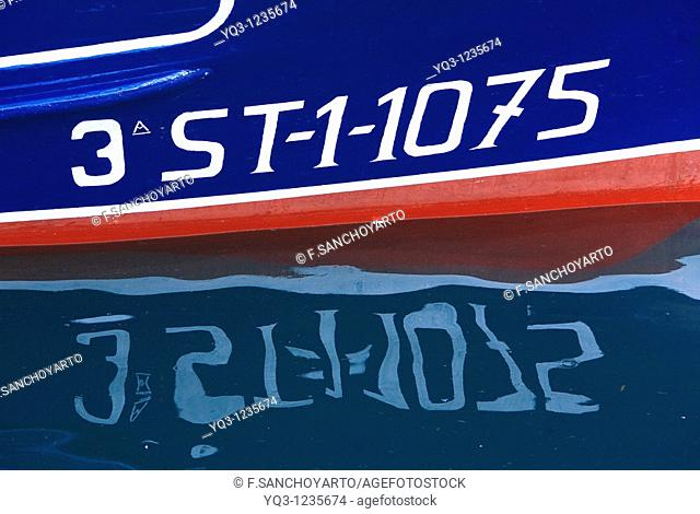 Reflection of boat, detail, Castro Urdiales, Cantabria, Spain