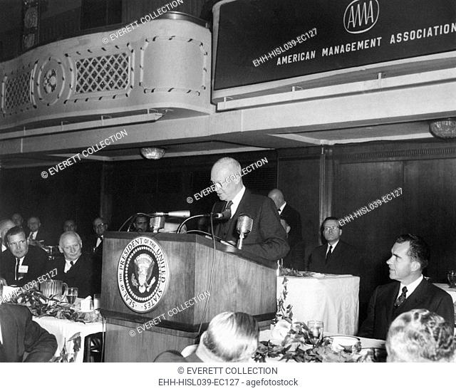 President Eisenhower speaking at American Management Association dinner. Vice President Richard Nixon is at right. Also attending was visiting World War 2...