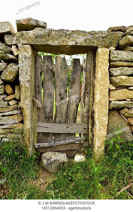 Popular architecture. Door and wall building with granite blocks and wood. Fornillos de Fermoselle, Sayago, Zamora Province, Castilla-Leon, Spain