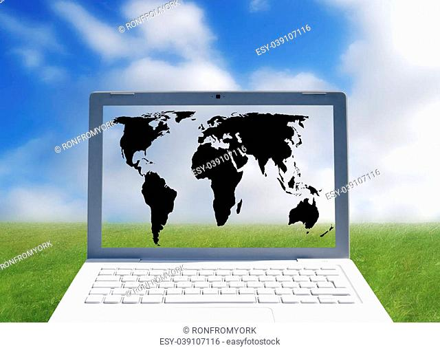 Laptop computer with world map over outdoor scene