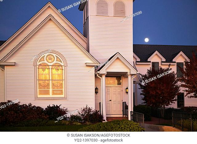 A church at sunset with a rising full moon on Solomon's Island, Maryland