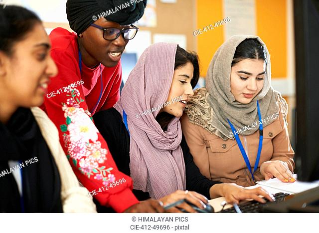 Female college students in hijab and dhuku using computer in computer lab