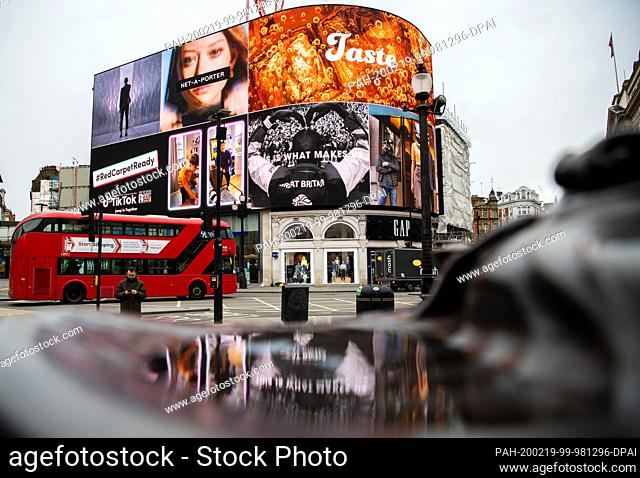 19 February 2020, Great Britain, London: A double-decker scheduled bus runs over Piccadilly Circus, a world famous crossroads and public square in London's West...