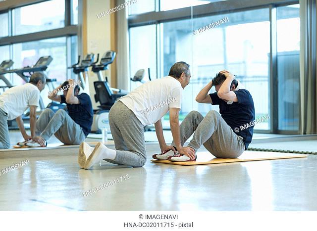Senior man exercising stomach muscles