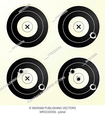Collection of four targets with increasing amounts of bullet holes