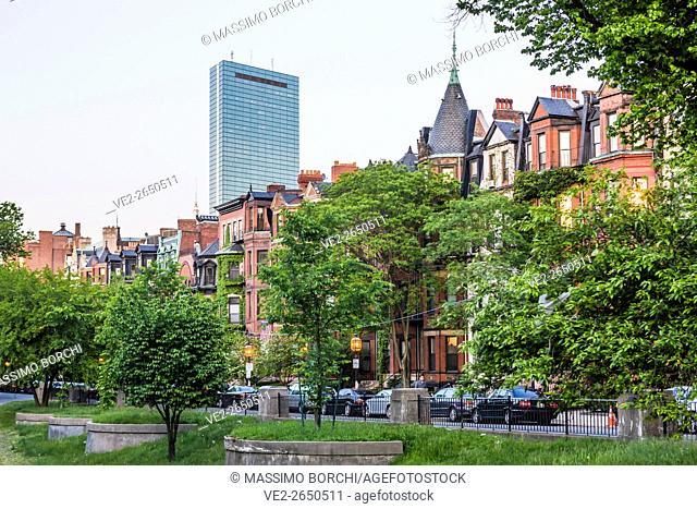 USA, Massachusetts, Boston . Houses in Commonwealth Avenue, John Hancock Tower on the background