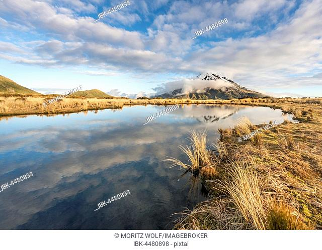 Reflection in Pouakai Tarn, stratovolcano Mount Taranaki or Mount Egmont, Egmont National Park, Taranaki, New Zealand