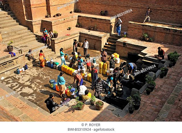 a lot of people getting water at a public water point in the city, Nepal, Patan