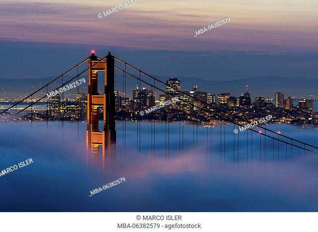 Just in front of the sunrise in the Golden Gate Bridge, San Francisco, California, the USA