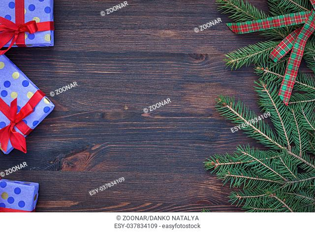 Brown wood background with festive decorations, empty space in the middle