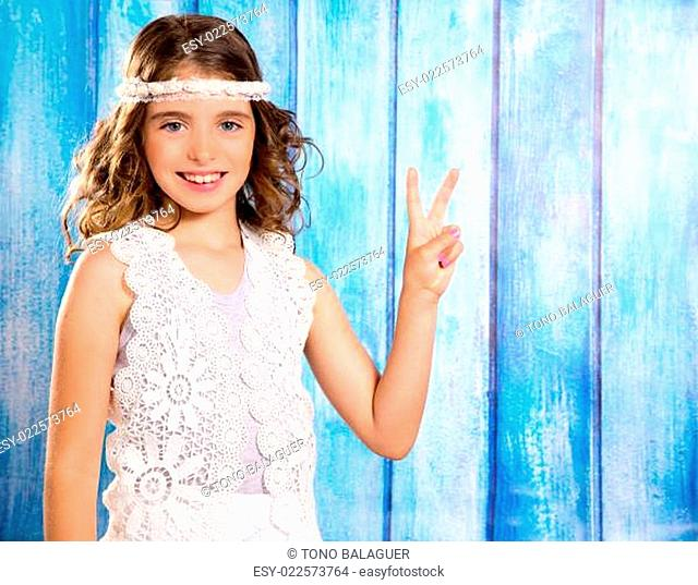 Happy hippie children girl smiling with peace hand sign