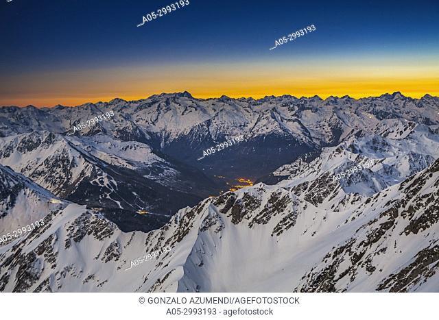 Sunset and view from Pic du Midi de Bigorre. On the left Vignemale mountain. On the right Balaitus mountain or Pic du Balaitous