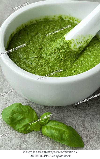 Green homemade Italian pesto in a mortar