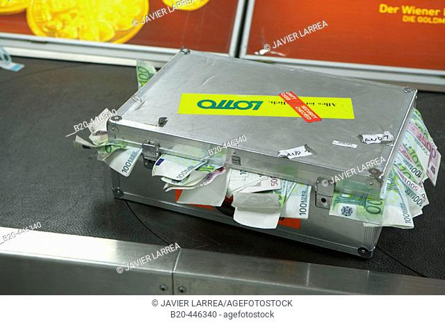 Suitcase full of money on airport baggage claim conveyer, advertising