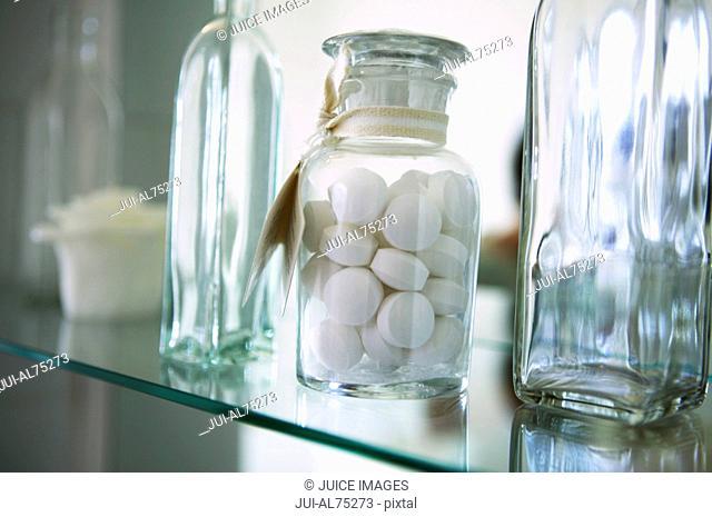 Close-up of bottles on a shelf