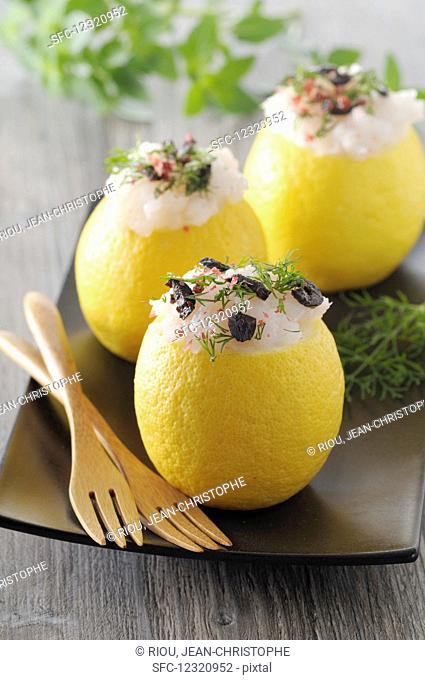 Lemons stuffed with cod, black olives and dill