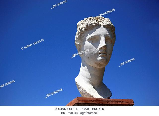 Bust of Apollo in the ruins of the ancient city of Butrint, UNESCO World Cultural Heritage Site, Butrint, near Saranda, Vlorë County, Albania