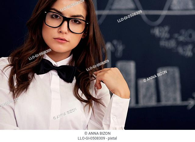 Portrait of woman with glasses and bow tie, Debica, Poland