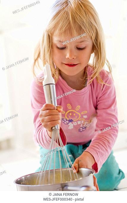 Little girl preparing mashed potatoes