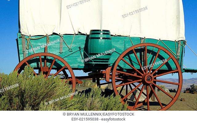 A covered wagon sits on the prairie along the Oregon Trail in eastern Oregon