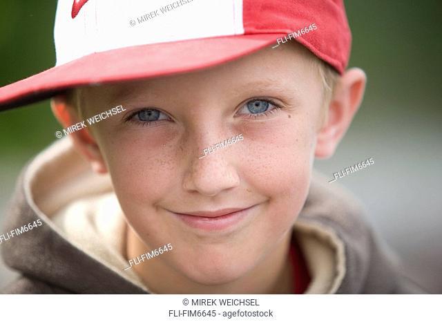 Portrait of a boy wearing a cap