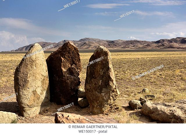 Mysterious Oshak Tas three standing stones in Altyn Emel National Park Kazakhstan