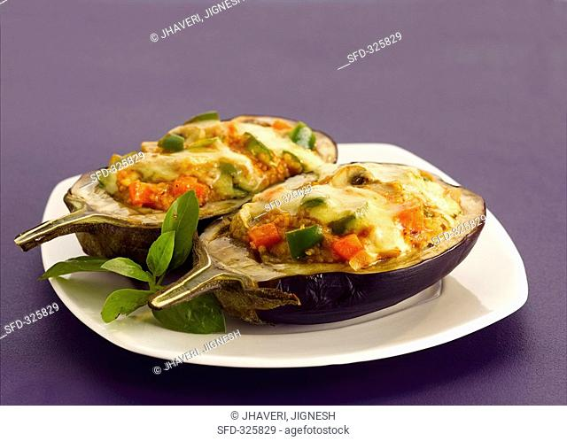 Stuffed aubergines with melted cheese topping India