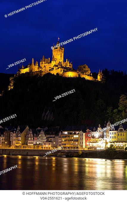 The beautiful Reichsburg Cochem (Cochem Imperial Castle) with village and the river Moselle in the foreground at night, Cochem, Rhineland-Palatinate, Germany