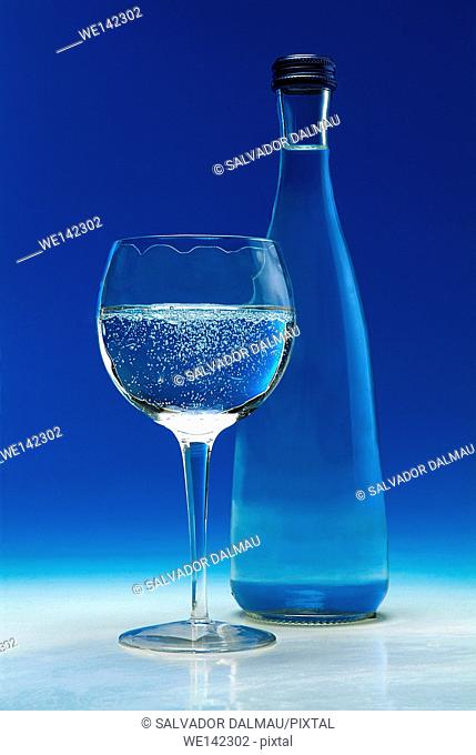 photography studio,glass and bottle of sparkling water, water bubbles,transparencies in water,location girona,catalonia,spain,europe,