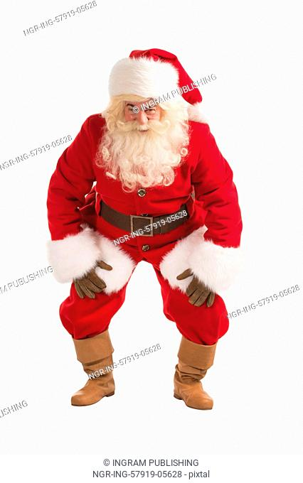 Happy Christmas Santa Claus with a funky dance pose. Isolated on white background. Full length