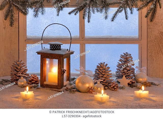 wooden lantern on windowsill with christmas decoration