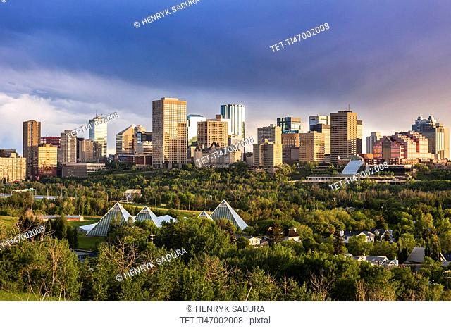 Canada, Alberta, Edmonton, Cityscape with trees in foreground