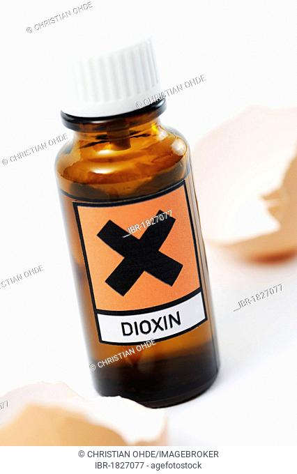 Small bottle labelled with a hazard symbol and a lettering Dioxin, symbolic image, chicken eggs contaminated with dioxin