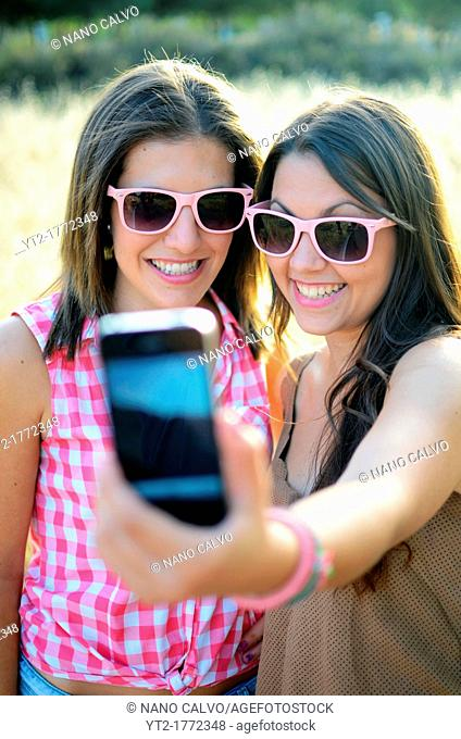 Two friends take a self portrait with a mobile telephone