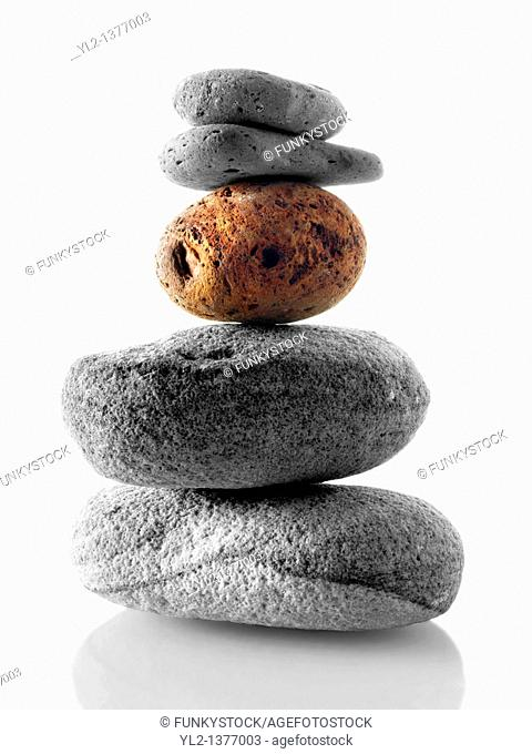 Stones stacked ontop of each other  Black and white with one coloured stone